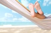 8361400-child-legs-on-hammock-at-sea-beach